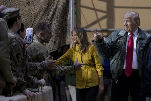 The US President and First Lady meet troops stationed in Iraq.