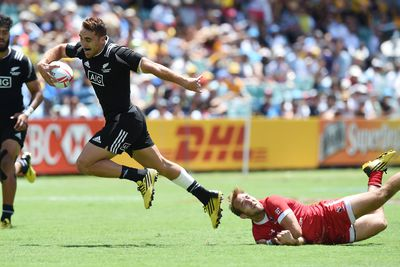 New Zealand's Joe Webber escapes the clutches of Canada's Sean White on his way to a try. (AAP)
