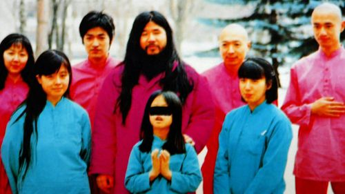 Cult leader Shoko Asahara with family members and his inner circle. (AP).