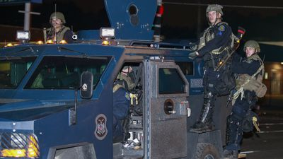 Police and National Guard have been ordered into Ferguson, Missouri, to quell the riots. (Getty)