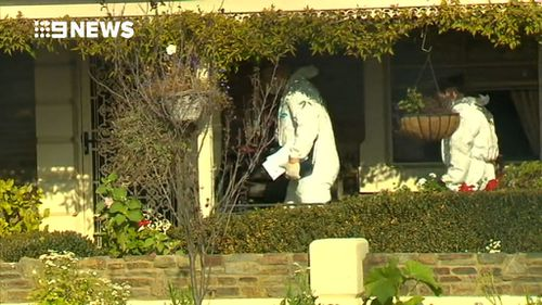 Police scoured the scene of the Millicent home. (9NEWS)