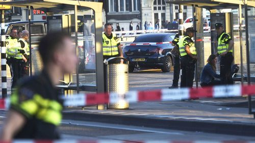 Police officers investigate at the Amsterdam Centraal station in Amsterdam, Netherlands. (AAP)