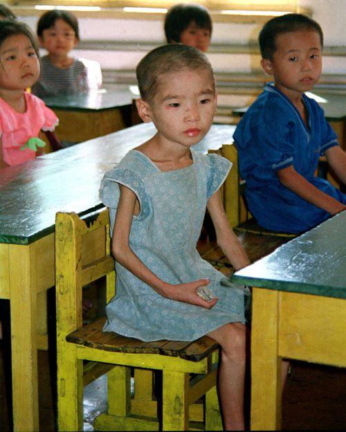 Nine and 10-year-old children looking like three or four-year-olds in a kindergarten due to famine in the southern resort of Hui Chong in North Korea.