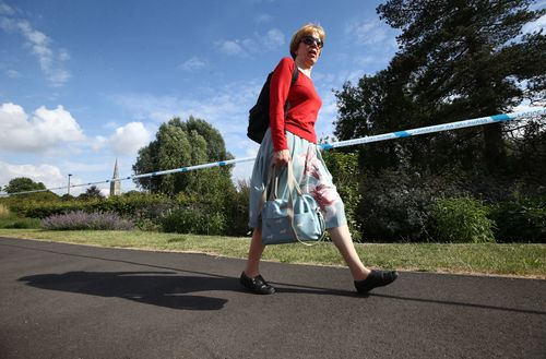 People walk past the park in Salisbury where the latest sick couple visited at the weekend. Picture: AAP