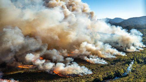 Fire crews are battling a raging bushfire hitting Tasmania's south east.
