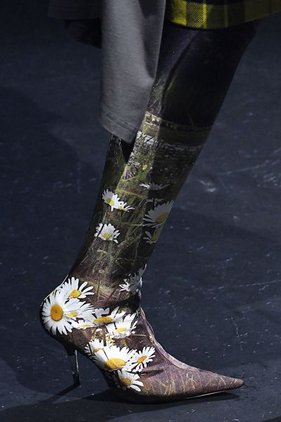 If Crocs aren't for you perhaps you'll enjoy a lycra boot with daisies?