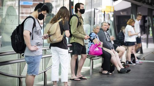 People with and without out Masks due to COVID-19 at Bus stops in George Street, Sydney.  12th October 2020.