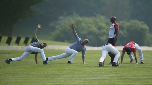 The Duke of Cambridge (second left) warms up with fellow players before the start of the polo match. (PA)
