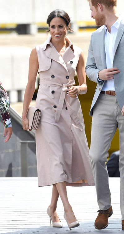 Meghan Markle in a sleeveless trench dress from NONIE for a visit to the Nelson Mandela Centenary Exhibition, July  2018
