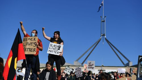 Protesters outside Parliament in Canberra today.