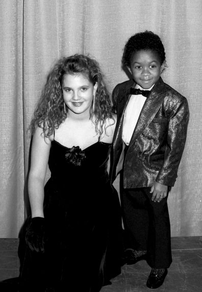 Drew Barrymore with fellow child star Emmanuel Lewis at the People's Choice Awards in 1987 1987.