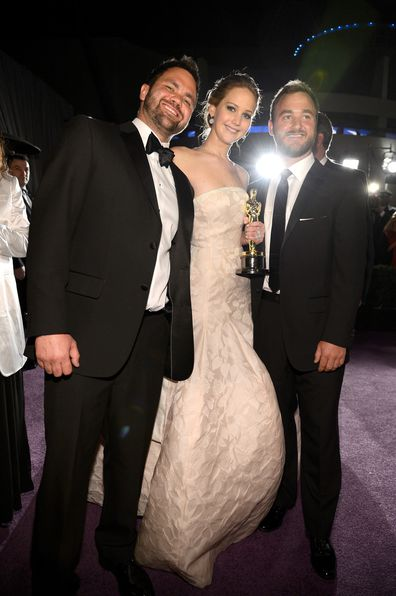 Jennifer Lawrence, winner of Best Actress for her role in 'Silver Linings Playbook' and brothers Ben Lawrence and Blaine Lawrence attend the Oscars Governors Ball at Hollywood & Highland Center on February 24, 2013 in Hollywood, California.