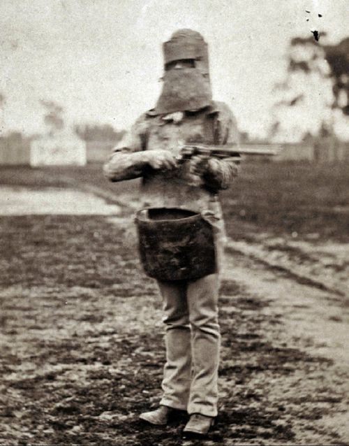 The bushranger was famous for his armour, worn here by a police officer after the outlaw's capture. (AAP/State Library of Victoria)
