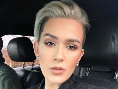 Beauty YouTuber Mel Thompson sitting in a car looking into the camera, taking a selfie.