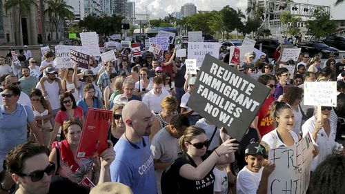Demonstrators take to the streets in Miami to protest Donald Trump's immigration detention policy. (AAP)