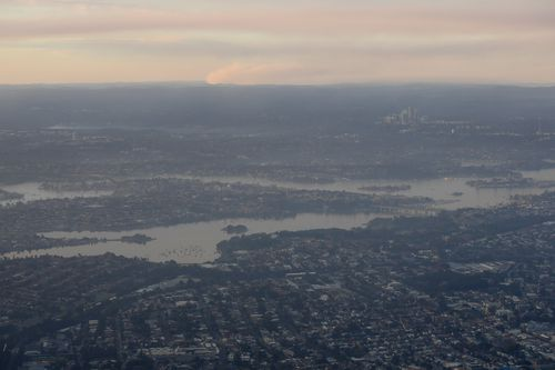 The smog over Gladesville, Drummoyne and surrounding suburbs as seen from a commercial airliner. (AAP)