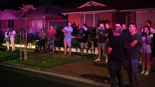 Local residents watch flames close to homes in Corryton Court, Wattle Grove. (AAP)