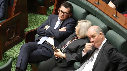 An exhausted Daniel Andrews sits in the Legislative Assembly during the marathon assisted dying debate. (AAP)