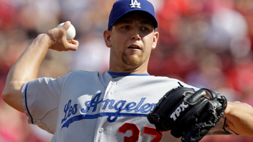 Los Angeles Dodgers pitcher Charlie Haeger (37) pitches against the Cincinnati Reds in the first inning of a baseball game, Saturday, Aug. 29, 2009, in Cincinnati. (AP Photo/Al Behrman)