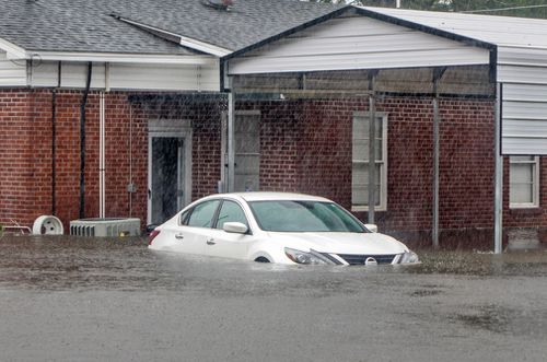 Heavy flooding is seen in Latta, South Carolina.