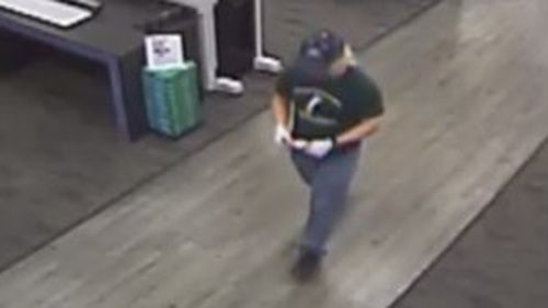CCTV shows him after he posted the package. (Supplied)