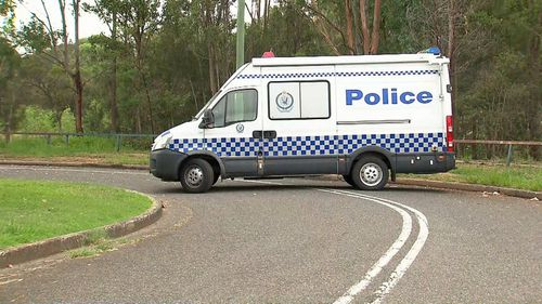 A police van closes the road leading in to the home to assist officers in their investigation.