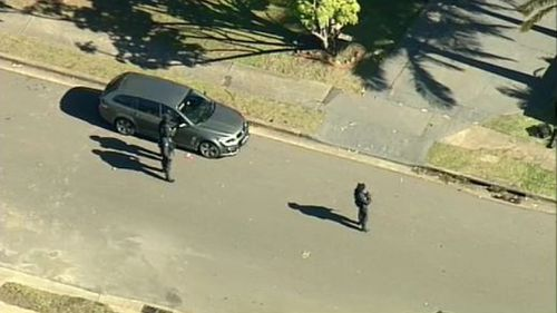 AFP officers are at a home in Bossley Park, in Sydney's west. (9NEWS)