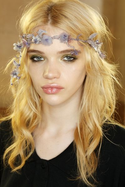 <p>Hair was beachy and wavy, free flowing from under dainty flower crowns.</p>