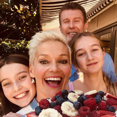 Peter Overton, Jessica Rowe and their two daughters.