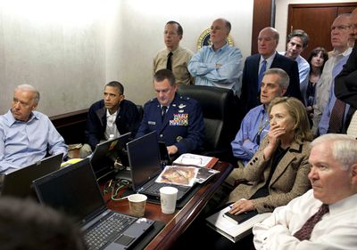 President Barack Obama and a team of his close advisors receive an update on the mission against Osama bin Laden in the Situation Room of the White House in Washington.