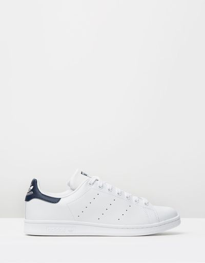 """<a href=""""https://www.theiconic.com.au/stan-smith-341862.html"""" target=""""_blank"""">Adidas Stan Smiths in Running White and Navy, $120.</a>"""