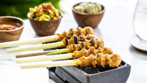 Sate lilit (minced seafood satay grilled on lemongrass