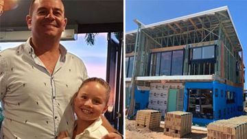 Clint Calman with his daughter Charli, and the townhouse he will move into when it is completed in six weeks' time.