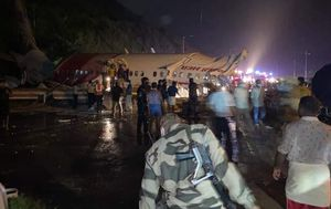 Air India plane crashes in Calicut after skidding off the runway, killing at least 16 and injuring hundreds