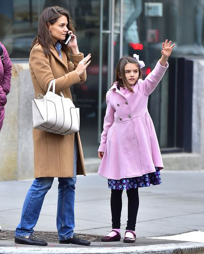 It's bow time - Suri Cruise and mum Katie Holmes in New York hailing a cab.