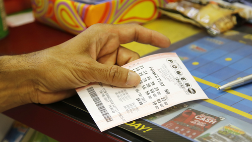 A customer buys a Powerball ticket, Thursday, June 8, 2017, in Chicago. The Powerball jackpot has grown up to $435 million, after more than two months without a winner. The jackpot for Saturday night's drawing would tie for the nation's 10th largest lottery prize. (AP Photo/G-Jun Yam)
