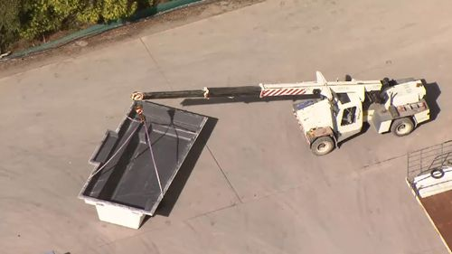 Man dies after being struck by crane at Gold Coast swimming pool business