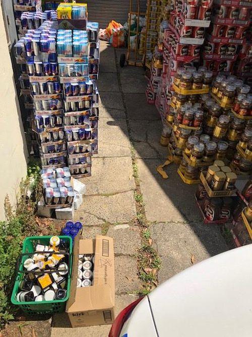 Cartons of Red Bull, Moccona Coffee, tuna and assorted chocolates.