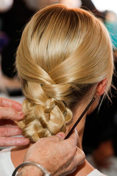 Hair was braided at the back then tucked under at Marchesa.