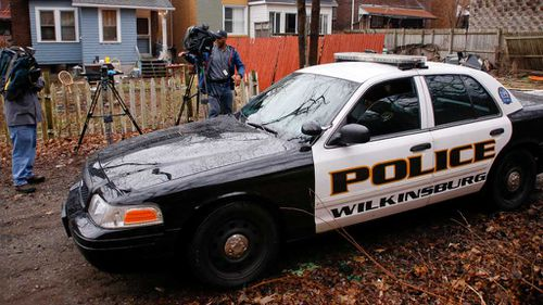 Wilkinsburg police drive past the scene. (AAP)
