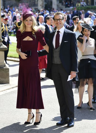 Aussie actress Jacinda Barrett with cut outs in all the right places, with husband and Meghan Markle's former Suits co-star<strong></strong>Gabriel Macht photographed at the Royal wedding