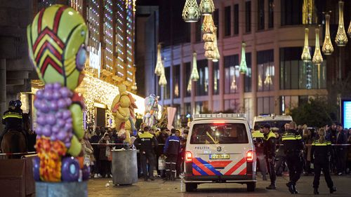 Dutch police block a shopping street after a stabbing incident in the centre of The Hague, Netherlands, Friday, Nov. 29, 2019.
