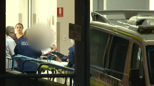 A young man was arrested after two women were stabbed in a Sydney home. (9NEWS)