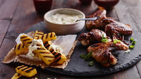 Devilled chicken wings with polenta chips and mustard cream