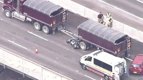 Motorcyclist dies in two truck collision on Sydney's M4