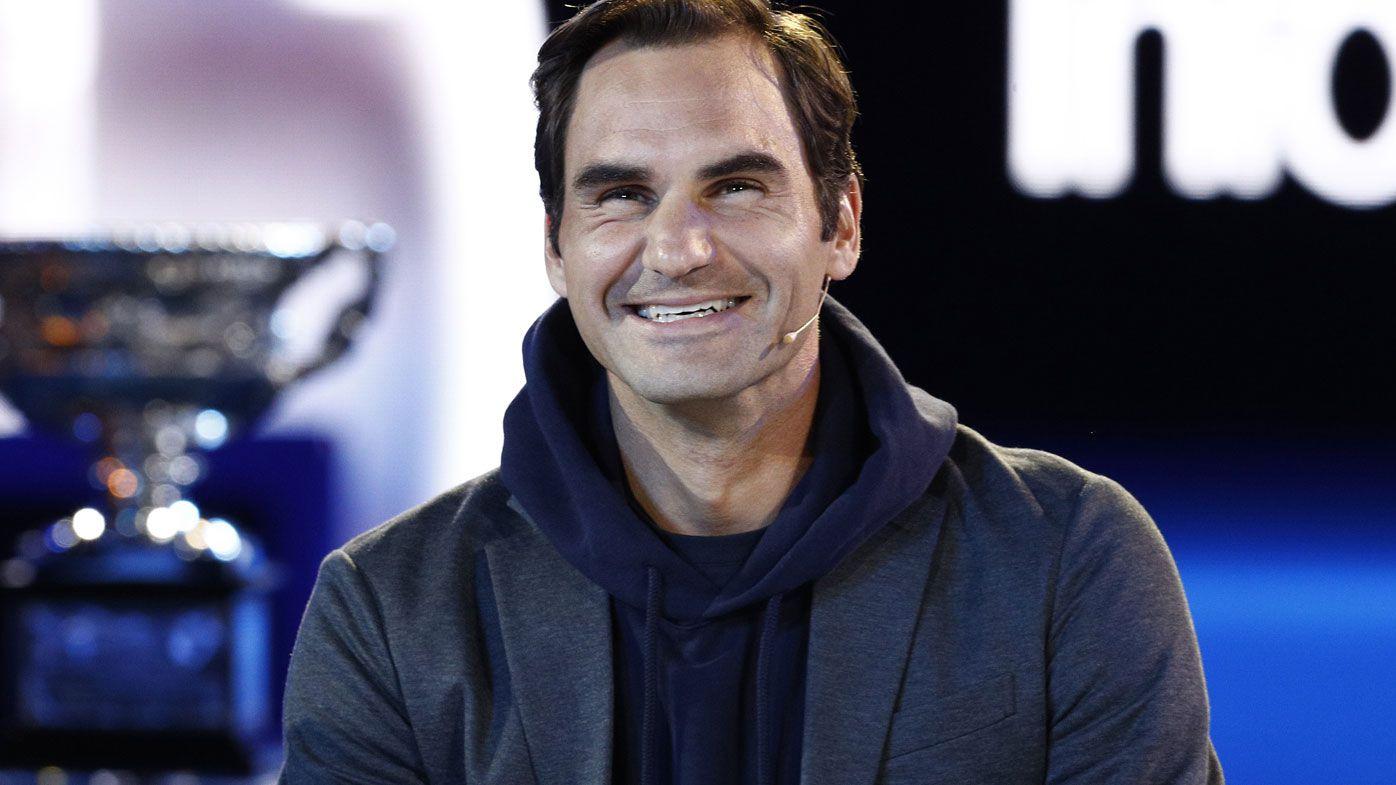 Roger Federer wears a grin