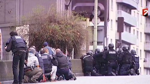 Plain clothes and heavily-armed police near the Kosher grocery store in Paris. (Supplied)