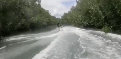 The fisherman loves the water and often goes jet-skiing on the river.
