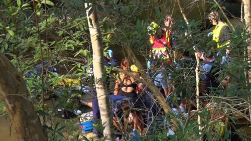 'He died in his arms': Witnesses describe NSW waterfall horror