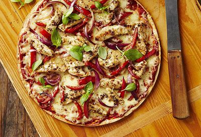 Mediterranean chicken pizza with basil